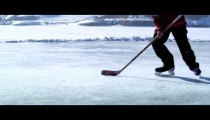 Royalty Free Stock Footage of Close up of a boy playing hockey at an outdoor ice rink.