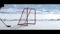 Royalty Free Stock Footage of Close up of a boy practicing hockey at an outdoor ice rink.