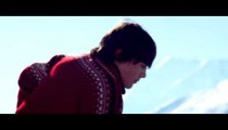 Royalty Free Stock Footage of Young boy in a red sweater practicing hockey outdoors.