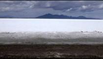 Expansive shot of the Bonneville Salt Flats in a Utah desert.