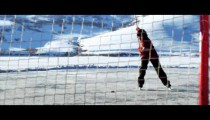 Royalty Free Stock Footage of Young boy skating towards a hockey net; about to make a goal.