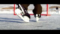 Royalty Free Stock Footage of Close-up of an outdoor ice rink, hockey net, and skates.