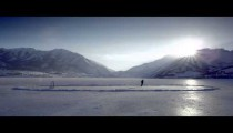 Royalty Free Stock Footage of Someone playing hockey on a frozen pond.