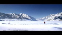 Royalty Free Stock Footage of Frozen pond and someone playing hockey.