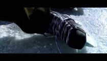 Royalty Free Stock Footage of Close up of a hockey skate at an outdoor rink.