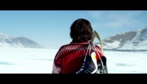 Royalty Free Stock Footage of Youth walking across a frozen lake with hockey gear.