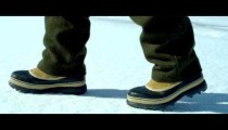 Royalty Free Stock Footage of Boots walking across the snow-covered ground.