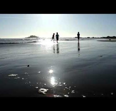 Little girls running on beach