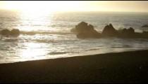 Evening waves crashing on rocks