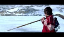 Royalty Free Stock Footage of Young boy walking through snow with hockey gear.