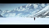Royalty Free Stock Footage of Person walking through the snow in the distance.