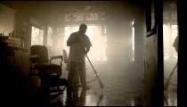 Royalty Free Stock Footage of Barber sweeping floor.