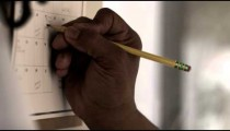 Royalty Free Stock Footage of Close up of a hand writing on a calendar.