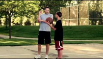 Royalty Free Stock Footage of Father and son playing basketball in a park.