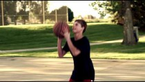 Royalty Free Stock Footage of Dad and boy playing basketball in a park.