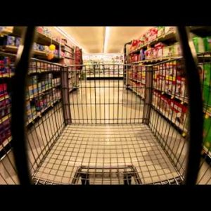 Time-lapse of a shopping cart moving down aisles.