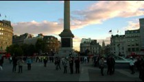 Tourists near Nelson's Column in Trafalgar Square at sundown on October 7, 2011 in London.