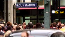 Buses, cars and people close to Circus Station on October 8, 2011 in London.