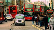 Cars, people and double-deckers in slow motion on October 8, 2011 in London.