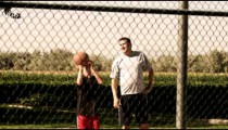 Father playing basketball with his son.