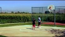 Royalty Free Stock Footage of Boy playing basketball with his dad in the park.