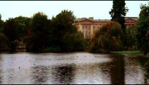 Panning view of Saint James Park waterway with Buckingham Palace