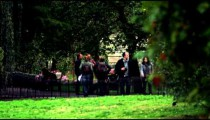 People walk in a park on October 8, 2011 in London.