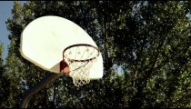 Royalty Free Stock Footage of Dad playing basketball with his son in a park.