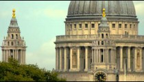 close-up of main dome of St. Paul's Cathedral and passing traffic in London