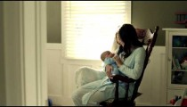 Royalty Free Stock Footage of Mother with baby in a rocking chair.