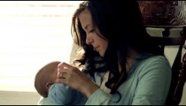 Royalty Free Stock Footage of Mother in a rocking chair with her baby.