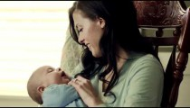 Royalty Free Stock Footage of Baby being rocked to sleep by its mother.