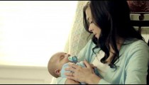 Royalty Free Stock Footage of Mother and baby in a rocking chair.