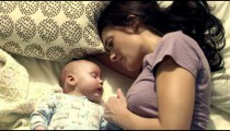 Royalty Free Stock Footage of Baby and mother in bed.