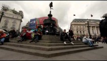 Unidentified people sit on the steps of the Eros statue on October 7, 2011 in London.