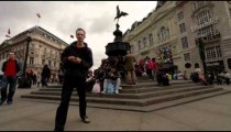 People eat on the steps of the Eros statue in London.
