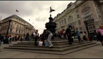 People walk by the Eros statue on October 7, 2011 in London.