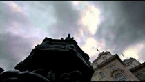 Birds flying around the Eros statue in London