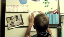 Royalty Free Stock Footage of Student posting grade on the refrigerator.