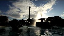 Trafalgar Square fountain and Nelson's monument with amazing light effect