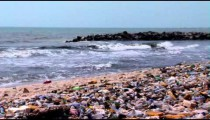 Polluted beach in Africa zoom out.