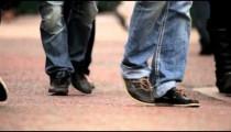 Legs and feet of unidentified people walking in London