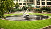 Stationary view of Revolving torsion Fountain Sculpture in London, England.