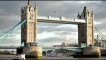 Stationary shot of Tower Bridge, white ship on the left, located in London, England.