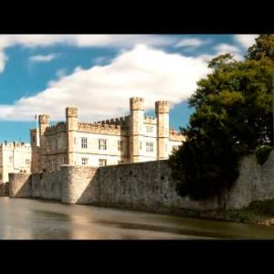 Time-lapse of exterior of Leeds Castle and moat in England.