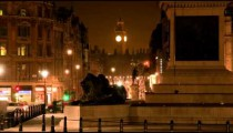 Big Ben and a lion statue in a night time-lapse shot in London.