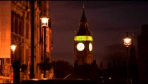 Time-lapse of Big Ben with traffic and people in the foreground.