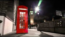 Tracking time-lapse of Big Ben behind a telephone booth in London.