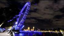 Time-lapse of the London Eye Ferris Wheel at night.