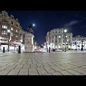 Time-lapse of traffic around Charing Cross in London at night.